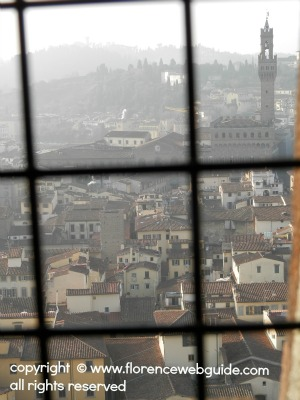 a view of Florence's Palazzo Vecchio from a window inside the Dome stairwell