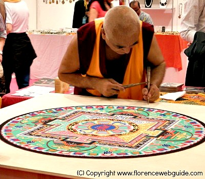 Tibetan art of sand mandala at the Art Fair in Florence