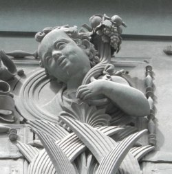 Cherub on frame of Pisano door