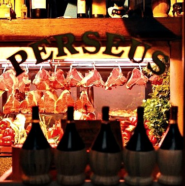 Look through the window at Perseus steaks hanging