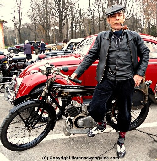 Gentleman in period garb with his vintage motorcycle at the Cascine park in Florence on Jan. 6, Feast of the Epiphany