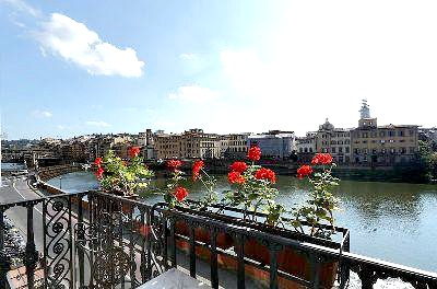 Wrought iron balcony looking out on the Arno from Hotel Bretagna