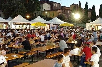 People enjoying the evening in Florence at the Baviera festival