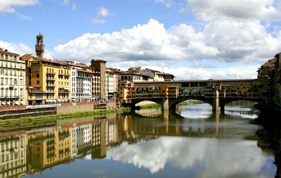 Classic lungarno view of river and Ponte Vecchio