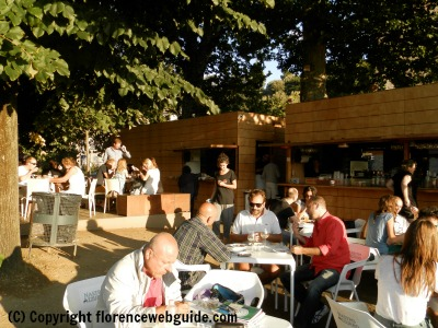 People gather in the shady piazza for an aperitivo at Easy Living