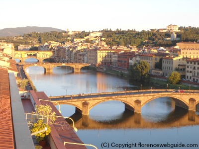 View of Arno and bridges at dusk from SESTO