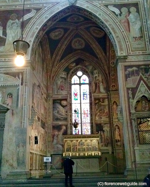 A private chapel decorated with frescoes and stained glass windows