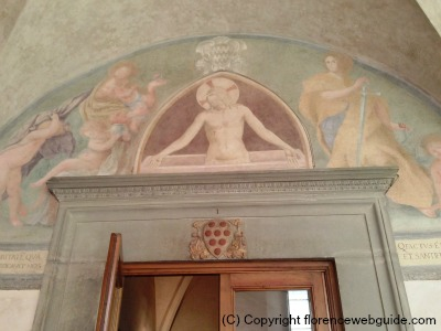 Fra Angelico fresco and Medici shield just above door