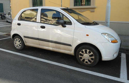 Car parked in white lines for residents only in Florence Italy
