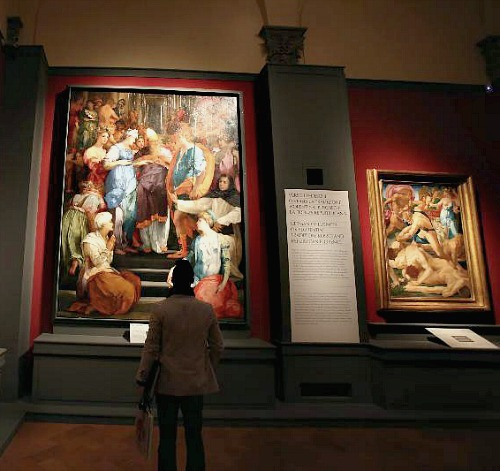 A visitor at the Pontormo and Rosso Fiorentino exhibit at Palazzo Strozzi