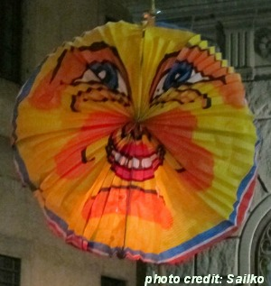 a paper lantern on a stick for Rificolona fest