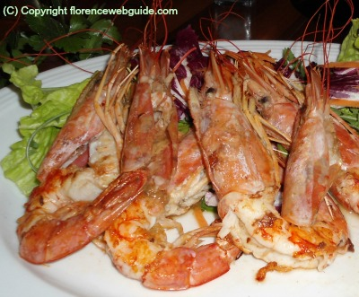 Grilled jumbo shrimp at a Florence fish restaurant