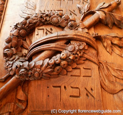 Wood door on right side of basilica with Hebrew writing