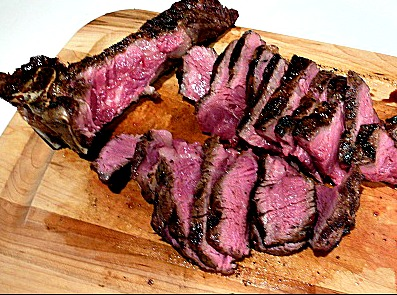 Steak sliced on cutting board