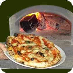 Florence Restaurants - Pizza Places - pizza coming out of wood fired brick oven