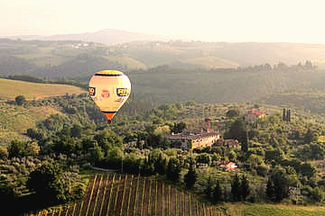 Hot air balloon coasting over the Tuscan countryside