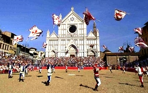 Florence flag throwers perform in front of Santa Croce before the historic football match in June