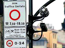 Traffic sign warning about the restricted driving zone with camera for catching drivers without authorization