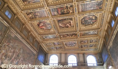 a shot of the many painted panels covering the ceiling of Palazzo Vecchio