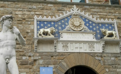 Main entrance to Palazzo Vecchio with symbols of Florence: David, lions and the giglio flower