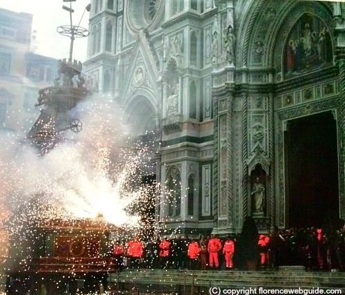 The centuries old cart 'explodes' in a pyrotechnic display in piazza Duomo