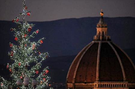 Top of Christmas tree at piazzale Michelangelo with Brunelleschi's cupola
