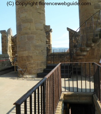 the top landing of the Arnolfo tower with merlons and spiral staircase