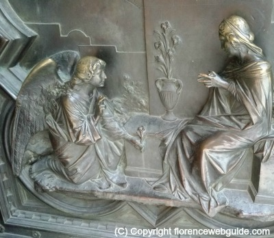 Angel Gabriel gives Mary a flower, relief on the cathedral door