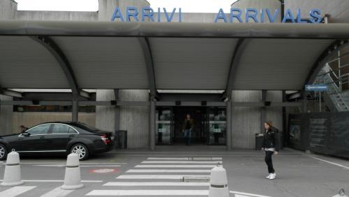 Arrivals doors at the Florence Italy Amerigo Vespucci airport, aka Peretola
