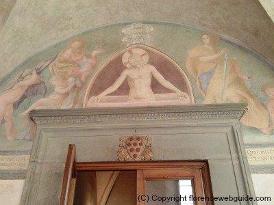 Fra Angelico fresco and Medici shield just above door