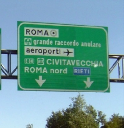 A green sign on the Autostrada