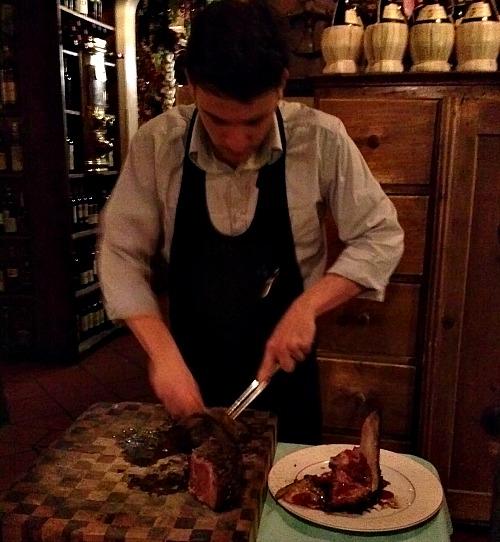 Steak being sliced on cutting board